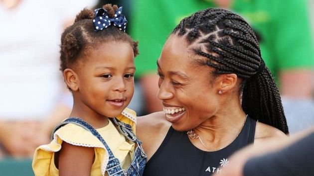 Allyson Felix celebrates with her daughter Camryn after finishing second in the women's 400-meter final at the 2020 U.S. Olympic track and field trials on June 20, 2021 in Eugene, Ore.